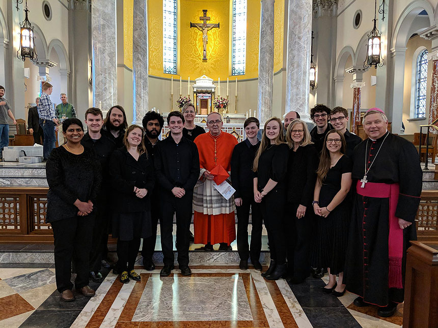 Jeff Rice, back row and third from right, travels with the Liturgical Choir of N.C. State Catholic Campus Ministry. Here, they're pictured with Bishop Richard Stika (right) and Cardinal Justin Rigali (center) at Sacred Heart Cathedral in Knoxville, Tennessee.