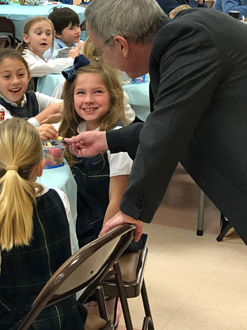 Bishop Luis Rafael Zarama visited St. Egbert School in Morehead City Jan. 29 during Catholic Schools Week. The school and parish are recovering from damaged caused by Hurricane Florence last year.