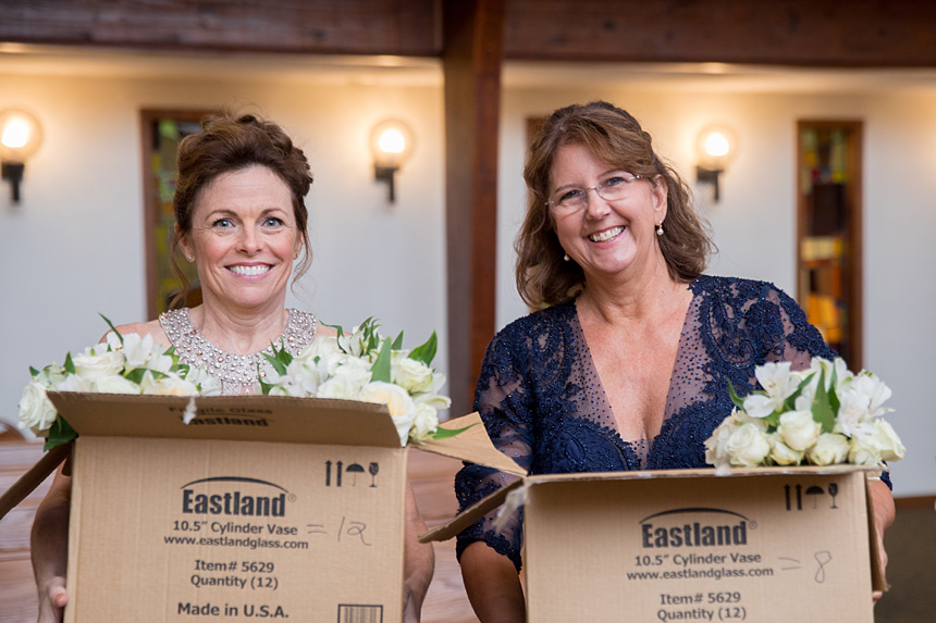 The mother of the bride and mother of the groom hold wedding flowers before the Sept. 15 nuptials of their children in Durham at Holy Infant Church.