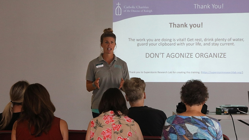 Emilie Hart, of Catholic Charities Cape Fear Office, trains canvassers at a Sept. 28 meeting in Wilmington.