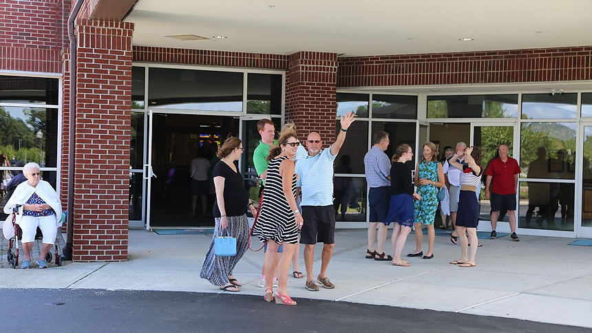 People gather outside St. Brendan the Navigator Church after Mass Aug. 19.