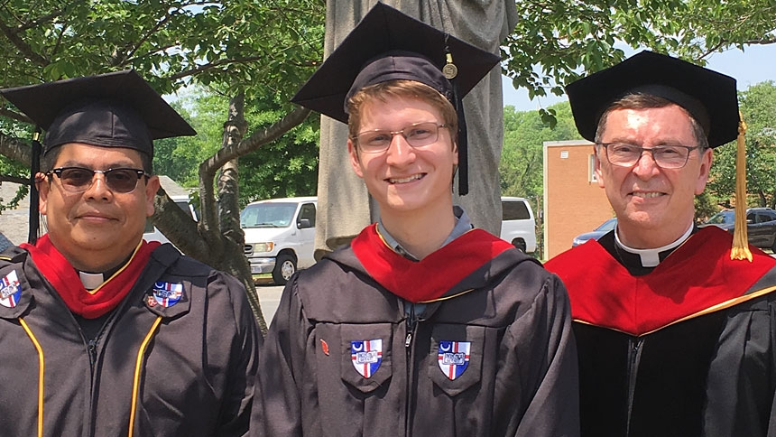 In 2018, Fr. Rafael León of the diocesan Marriage Tribunal received a licentiate in Canon Law and Mr. Christopher Neyhart of St. Thomas More in Chapel Hill received a bachelor's degree in Theology. They are with Rev. Monsignor Michael Clay, associate dean and associate professor in the School of Theology and Religious Studies.