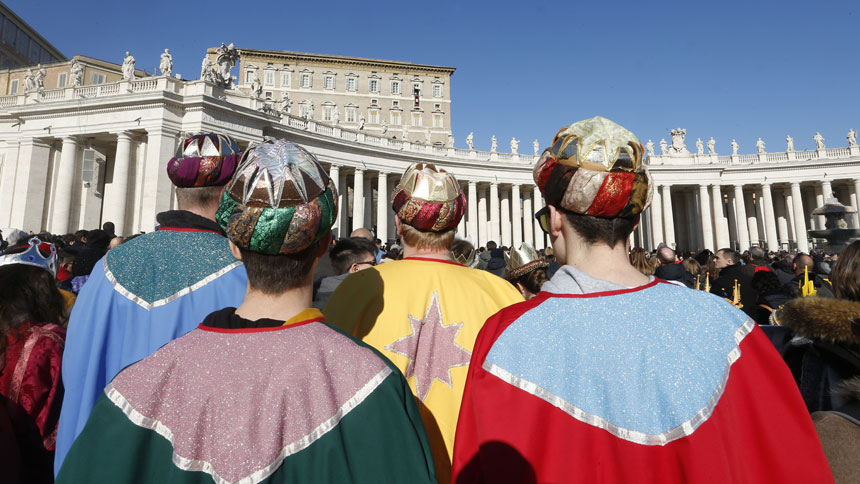 Children dressed as the Magi attend the Angelus led by Pope Francis from the window of his studio overlooking St. Peter's Square at the Vatican Jan. 1, 2020.
