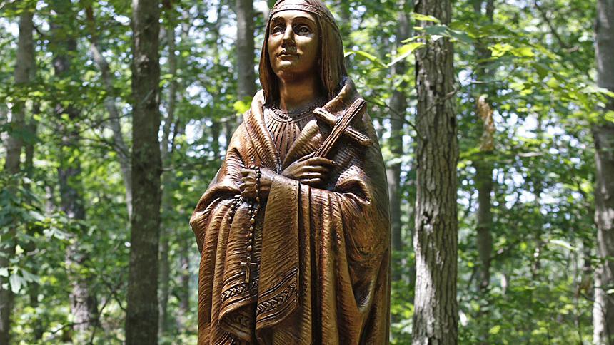 A statue of St. Kateri Tekakwitha is seen at Our Lady of the Island Shrine in Manorville, N.Y. The saint's feast day is celebrated July 14 in the U.S. and April 17 in Canada. (CNS photo/Gregory A. Shemitz)