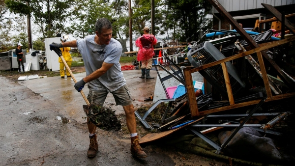 Volunteer help with cleanup after Florence called an act of 'faith, love'