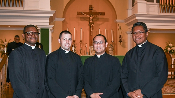 Four seminarians become candidates for holy orders