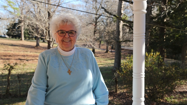 Sister Damian Jackson, O.S.F., 87, stands on the porch of her Durham home near Avila Retreat Center, where she served as director for three decades. This year Sister Damian celebrates her 65th jubilee.