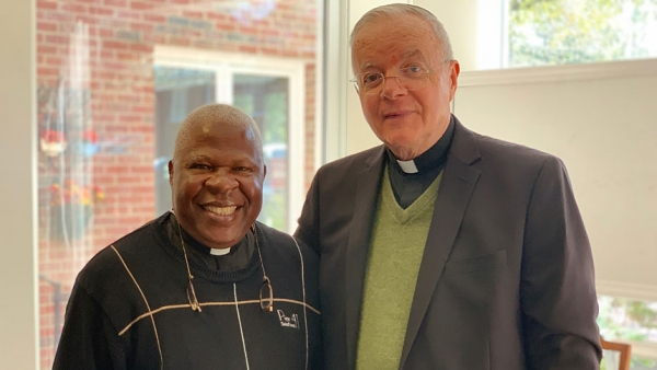 Father Joe Kakooza (left), of the Kasana-Luweero Diocese, and Monsignor Michael Shugrue, of the Diocese of Raleigh, work together for wells and school lunches in Uganda.