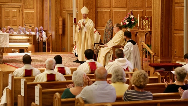 Father John Forbes is installed at Sacred Heart in Pinehurst June 28.