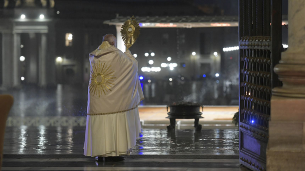 "Pope Francis holds the monstrance as he delivers his extraordinary blessing ""urbi et orbi"" (to the city and the world) during a prayer service in the portico of St. Peter's Basilica at the Vatican March 27, 2020."