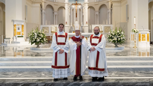 Seminarians Steven DiMassimo and Tyler Sparrow became transitional deacons May 23 at Holy Name of Jesus Cathedral in Raleigh.