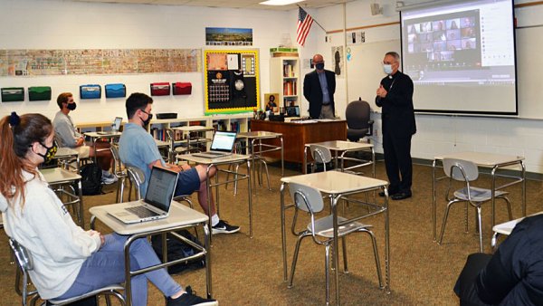 Bishop fields students' questions during Gibbons visit